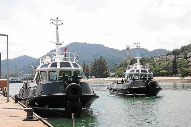 The two new tugboats at Boustead Naval Shipyard